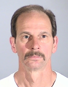 Torrance, California Police Department Booking Photo of El Segundo firefighter Michael Joseph Archambault, arrested on April 12, 2011 for shoplifting five products totaling $354.95 from Costco.